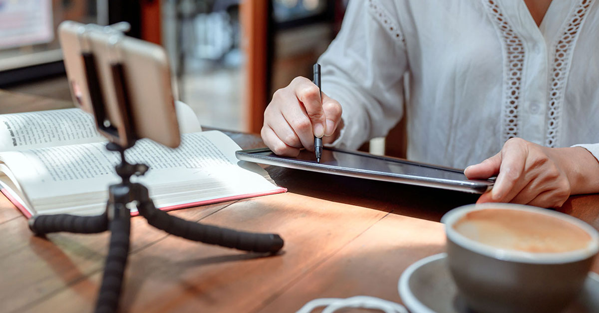 Blended learning with person using smartphone and tablet