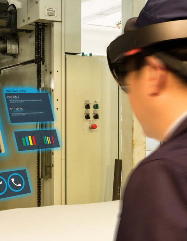 Man using augmented reality to learn how to operate machinery at work