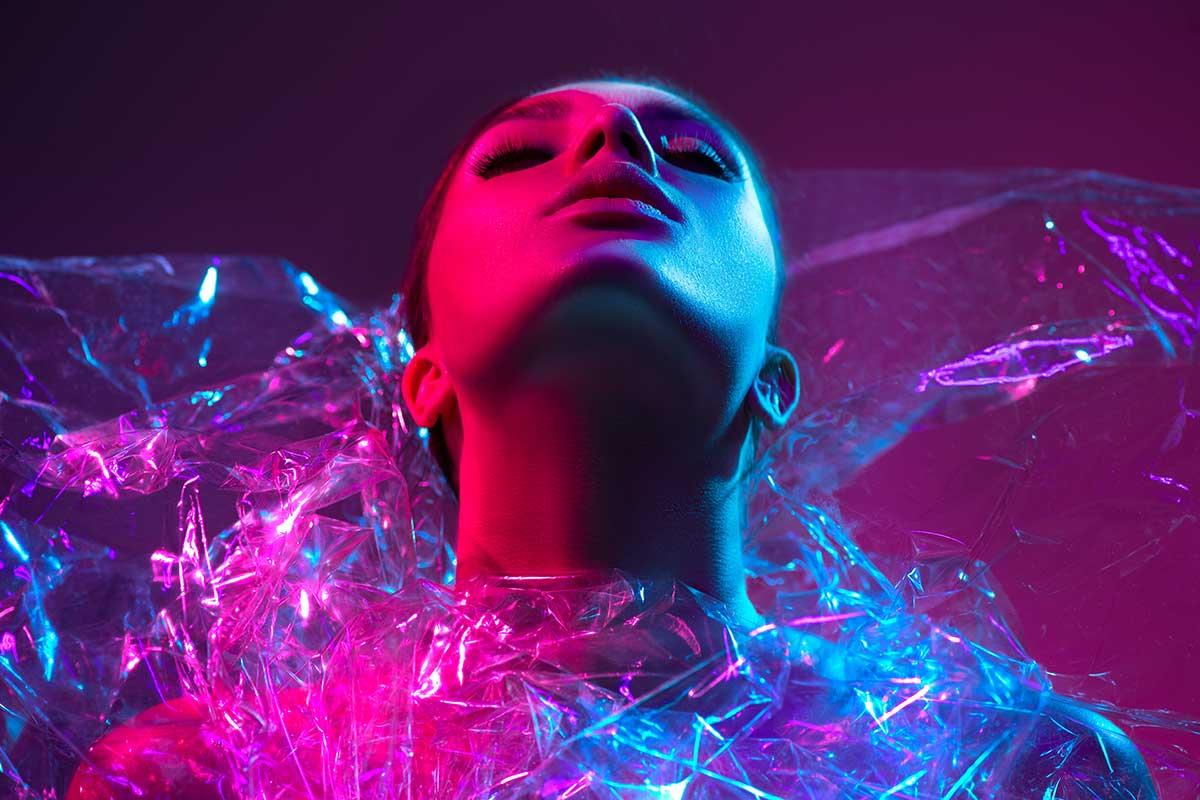 Fashion model in modern clothes and neon lights