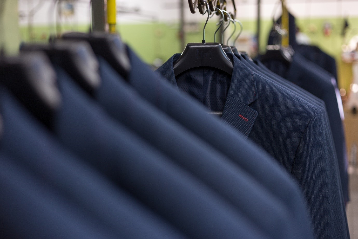 Fashion suits on a clothes rack