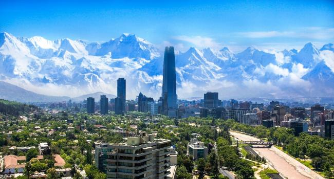 A view of the Chilean skyline with the city and mountains in the background