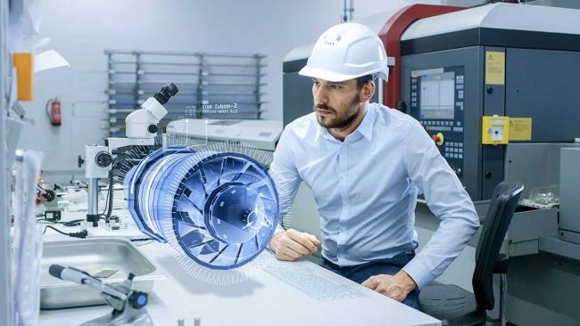 Man using augmented reality in manufacturing