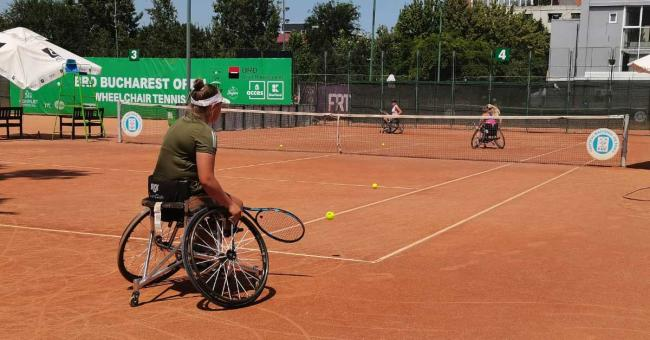 Women play wheelchair tennis in the ITF tournament