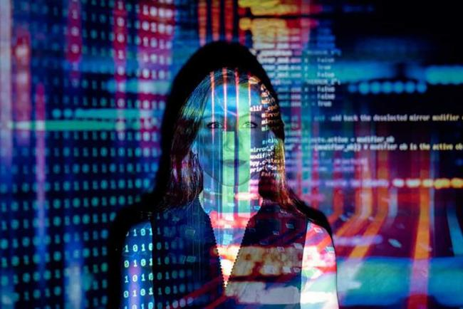 Woman with colorful data overlay