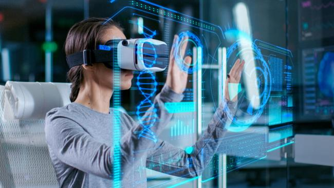 Scientist with Virtual Reality Headset interacts with holographic interface