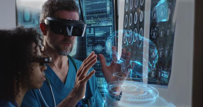 medical professionals using VR headset to examine human brain