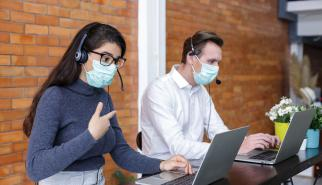Call center representatives working in masks