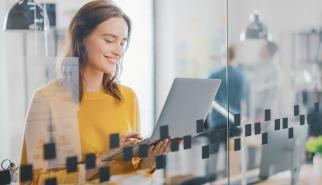 Fashion designer working on laptop in modern office