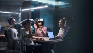 Staff use group virtual reality technology in the office