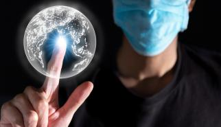 man wearing mask touch 3d graphic earth with light effect