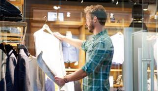 Young man shopping at fashion boutique