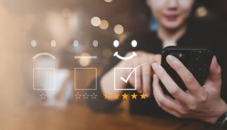 Woman giving five star rating on her mobile phone