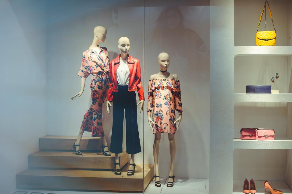 A women's fashion and apparel company showcasing their clothing line in a high-end storefront