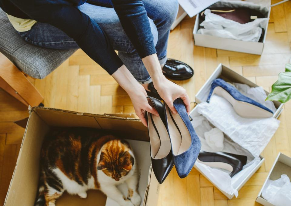 Woman opening boxes of shoes